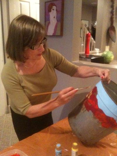 Judy Guglielmo preparing her sap bucket art for The Depot Theatre