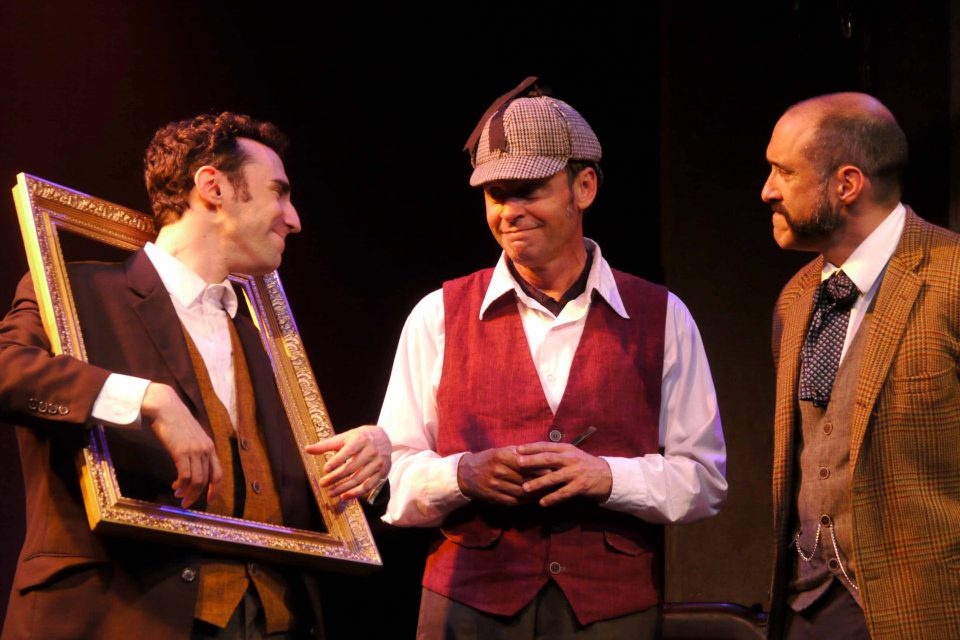 Kevin, Scott, and Jonathan (A portrait, Holmes, & Watson) smile as they begin to unravel the mystery