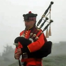Kevin Brew playing bagpipes atop Whiteface Mountain