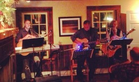 Local musicians Ben Bright, Donna Lou Sonnet and Donald Vicaro perform at the Essex Inn.