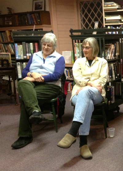 Diane Lansing and Donna Sonnet enjoying poetry open mic in Essex, NY