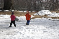 Children at Lakeside School carrying sugaring pails