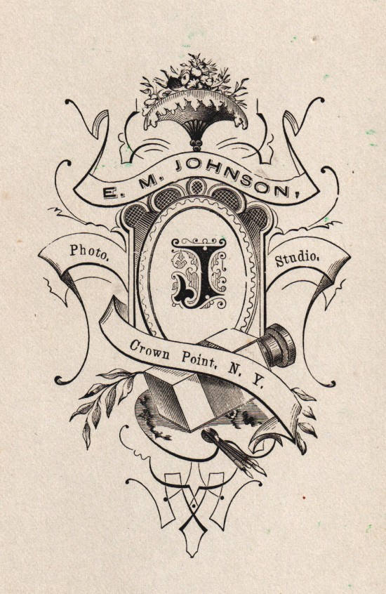 Crest on the back of stereoview. E.M. Johnson, Photo Studio, Crown Point, NY