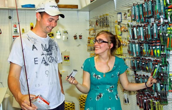 Pat McCauliffe, who traveled from Plattsburgh to purchase fishing equipment, discusses fishing lures with Willsboro Outdoor World proprietor Kristen Hotaling. (Credit: Alvin Reiner)