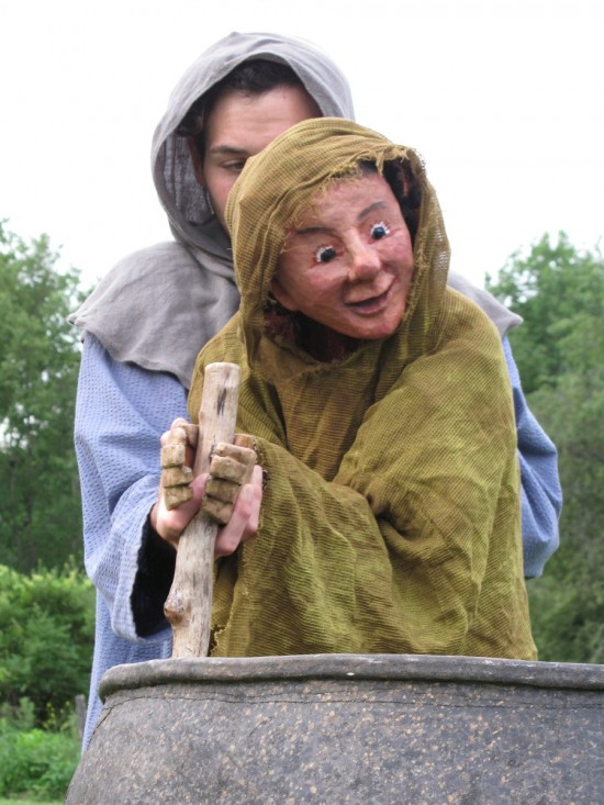 Puppet from Taliesin stirring a cauldron. (Credit: Mettawee Theatre Company)