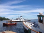 Tugboats playing on Lake Champlain between the Old Dock Restaurant in Essex, NY and the busy ferry dock.