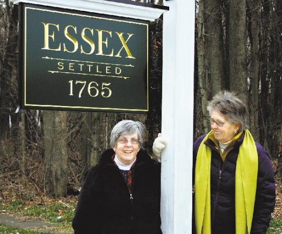Colleen Van Hoven (left) and Maureen Ecclesine of Essex Initiatives show off one of the recently erected road signs designating the hamlet of Essex. (Credit: Press Republican, Alvin Reiner)