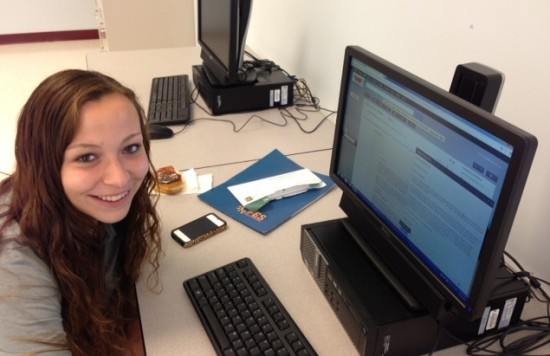 Katherine Belize works on a college essay with her mentor Tara Smith (not pictured) [Credit: CFES]