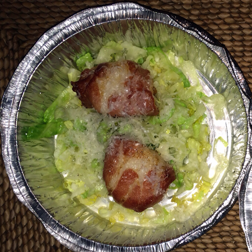 "Keith Castro's ""takeout"" diver scallops wrapped in prosciutto over lettuce and cheese."