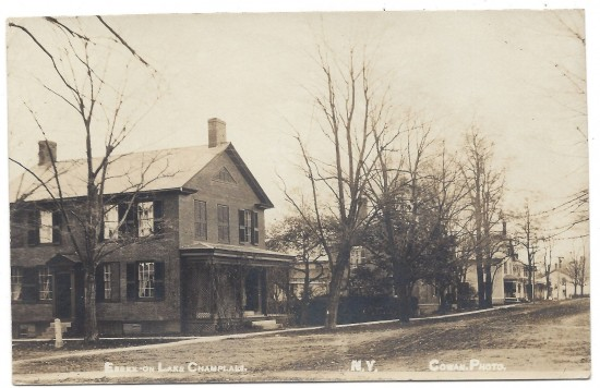 Vintage postcard depicting the corner of Church and Main Street in Essex, NY. The Ezra Parkhill House sits on that corner and features in this photo.