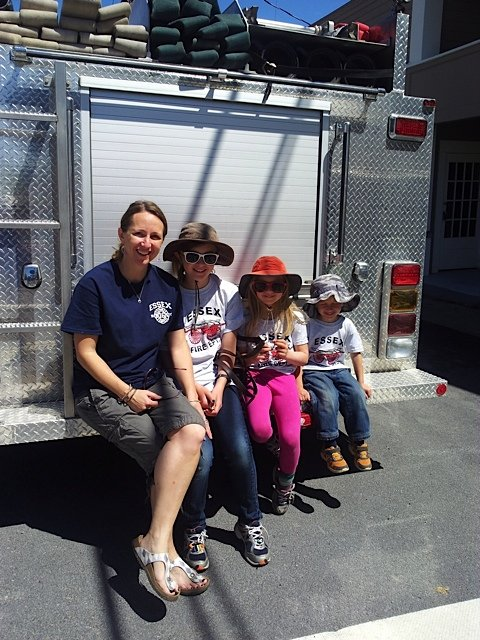 Preparing for their shift on the back of the fire truck: Wren, Luna and Otis Van Deusen and their mom, Jen Zahorchak.