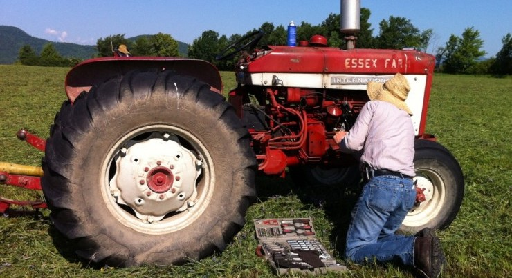 Worksing on an Essex Farm tractor (Credit: Kristin Kimball)