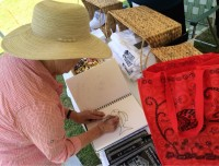 Dee Doodles: Dee Myers doodling an exotic fish during Essex Day 2014. (Photo: George Davis)