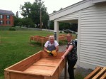 Louis Comeau and Meg Parker fabricate elevated beds for Essex Community Garden (Photo: LeeAnn Hoskins)