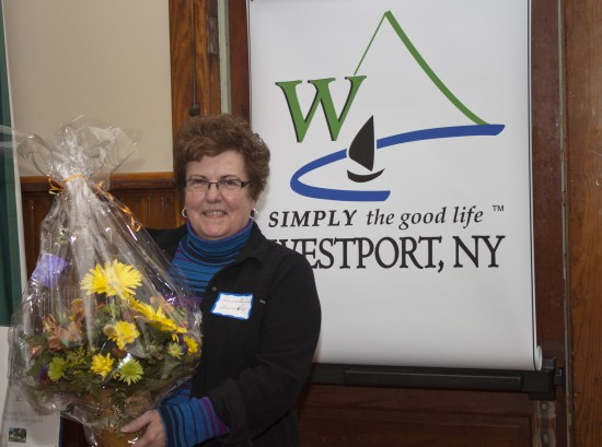 Julianne ? of Bessboro Shops?, winner of Person of the Year, in front of new Westport logo. (Credit: Jim Carroll/Overtime Photography)
