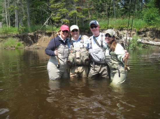 Fly fishing group in the river (Credit: Ken Kalil)