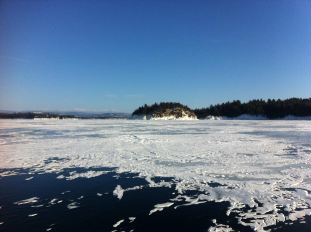 John Davis photographed this February 13, 2015 view of Lake Champlain. Can you see the coyote running along the shore?
