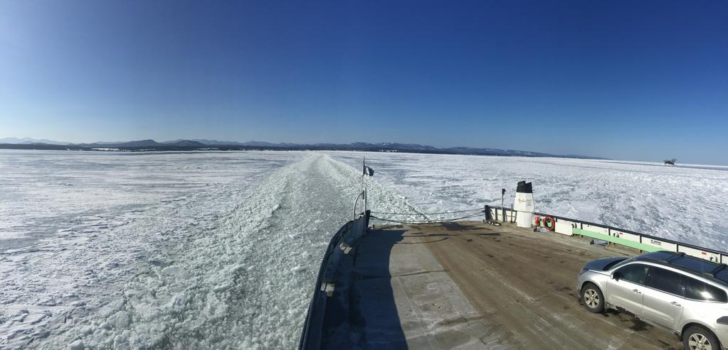 Richard Yeager's Lake Champlain winterscape captures the Adirondack Mountains from a ferry deck in the middle of the frozen lake.