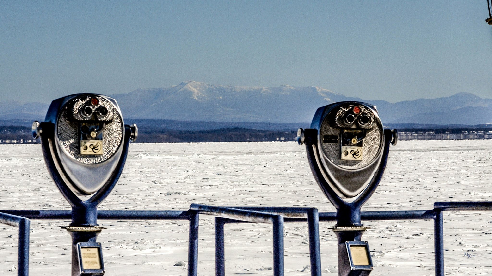 "Mt. Mansfield over a frozen Lake Champlain. Taken from Port Kent Ferry Dock this morning (Monday, February 16, 2015) by Michael Kedmenec. ""I can't recall this portion of the lake being frozen over before!"""