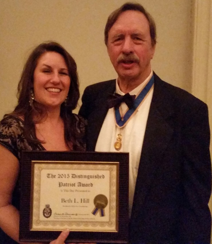 Beth Hill, President and CEO of the Fort Ticonderoga Association, received the 2015 Distinguished Patriot Award on February 20, 2015 by the Sons of the Revolution in the State of New York. (Image of Hill standing beside the President of the Society, Ambrose Richardson.)