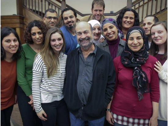 James Torczyner, centre front, founding director of ICAN McGill with fellows in the ICAN graduate fellowship program at McGill University in Montreal Wednesday February 25, 2015. (Credit: John Mahoney/Montreal Gazette)