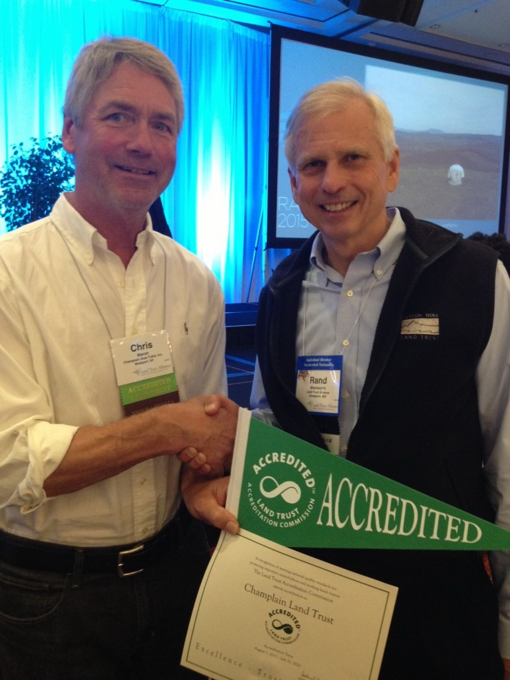 Chris accepts accreditation certificate
