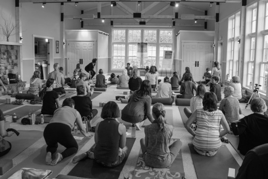 Participants settling onto their yoga mats in the CFES conference center at the 2015 UNYC (Credit: ZVD Photography)