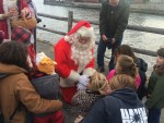 The Magic of Christmas in Essex 2015: Santa greets children at the Essex ferry dock