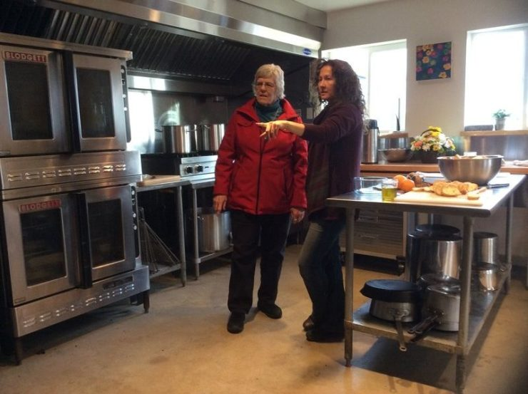 Hub on the Hill kitchen manager Susie Smith giving Diane Lansing a tour. (Credit: Kim Smith Dedam)