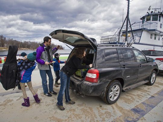 Ken Hughes and Susie Smith commute with their kids from Essex N.Y. across Lake Champlain via ferry to Vermont on Monday, February 1, 2016. Their kids, Wyatt Trzaskos, 10, Charlotte Hughes, 10, and Oliver Hughes, 7, attend the Waldorf School in Shelburne. (Photo: GLENN RUSSELL/FREE PRESS)