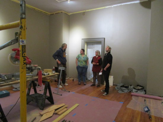 Steve Shepstone discusses work on the Rosenberg art gallery with museum staffers Whitney Jackson, Andrea Anesi and Owen Gibbs. The Adirondack History Museum's 2016 season focuses on programming highlighting Essex County artists as part of its celebration for the gallery opening. (Photo provided by the Adirondack History Museum)