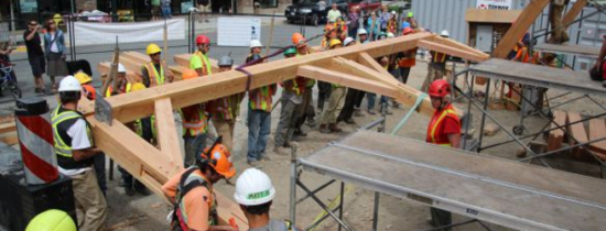 Since 1988, the Timber Framers Guild has collaborated with communities to create - and sometimes hand raise - over seventy-five timber frame structures. (Credit: Mack Magee)