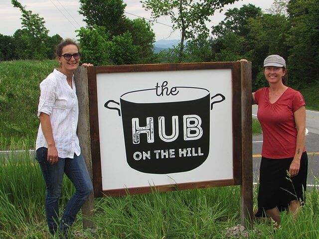 Hub on the Hill, a new business in Essex, will provide resources for local farms to process, pack, store, sell and distribute their items. Pictured here: Owner Jori Wekin and Manager Susie Smith pose at the launch party on June 2, 2016. (Credit: Pete DeMola)