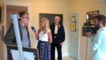 myChamplainValley morning news reporter Alaina Pinto interviews Tim Kapalvick and Jim Friday at the Adirondack Art Association on June 9, 2016 for ABC 22 and FOX 44. (Source: Christina Elliott, AAA Director)