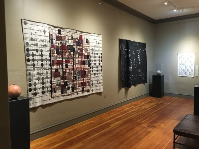 The beautiful new gallery with both Cynthia Schira's large tapestries and ten of Robert Segall's earthenware pottery on display.