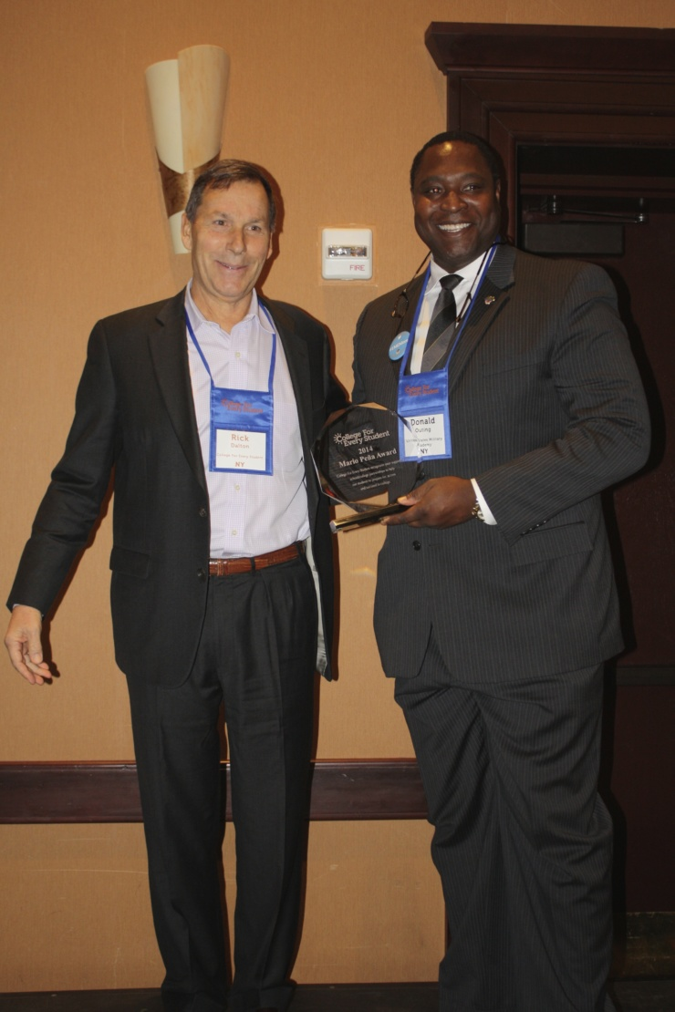 CFES President & CEO Rick Dalton presents an award to West Point's Chief Diversity Officer LTC(R) Don Outing at the 2014 CFES National Conference in Burlington, VT (Credit: CFES)