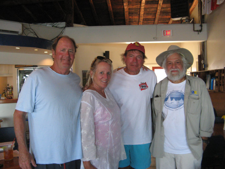 Sailors Peter and Denise Holmberg with David Meyer from Charlotte, VT, along with Ed Smith, of Willsboro, NY, after their race on Saturday, August 20, 2016, in The Galley Restaurant and Bar at Westport Marina. (Credit: Dee Carroll)