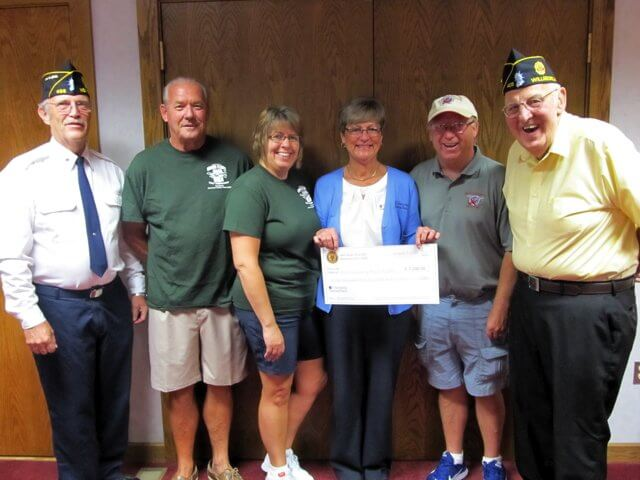 Pictured, L to R: American Legion William Nolan Post 405 Commander Lloyd Brockney; Jeff Kaleita, legion member and Golf Committee member; Joan Hubbard, Golf Committee member and major sponsor of Zeke's Pub; Gayle Bridge, Golf Committee Chair; North Country Honor Flight Director Barrie Finnegan and Richard Blanchard, member of American Legion William Nolan Post 405.