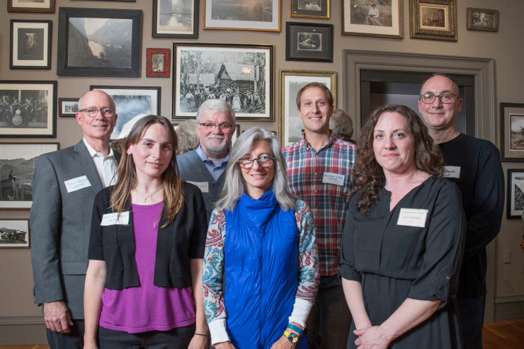 "(Back row) Curator Dan Keegan, Photographers Ed Williams, Johnathan Esper, Tony Beaver, (front row) Jessica Tabora, Nancie Battaglia and Museum Director Aurora McCaffrey were on hand to celebrate the Adirondack History Museum's opening with a gala reception for ""A Sense of Place: Photography of the High Peaks Region."" (Photo provided by Barry Goldstein)"