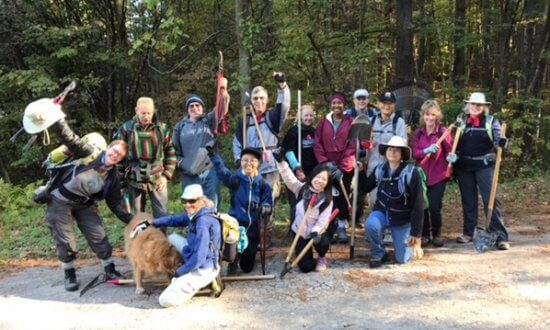 Thirteen Volunteer Vacationers joined Trail Steward Bill Amadon (second from left) and his Abby-the-Golden-Retriever on a frosty Monday morning to create a new CATS trail. (Credit: CATS)