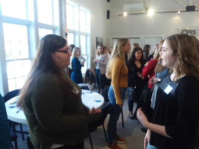 Karlee Witherbee of Ticonderoga and Azlin Peryer of Beekmantown introduce themselves to each other during a networking activity as part of the CFES engaging and empowering the young women of the Adirondack conference in Essex on Feb. 13. (Photo by Keith Lobdell)