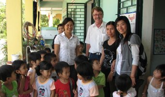 Mark Conroy at a school he built in the Danang area under the auspices of the East Meets West Foundation. Along with his brothers Pete and John, the three will host a panel discussion at the My Lai Memorial Exhibit Friday, Sept. 7, at 7:30 p.m.