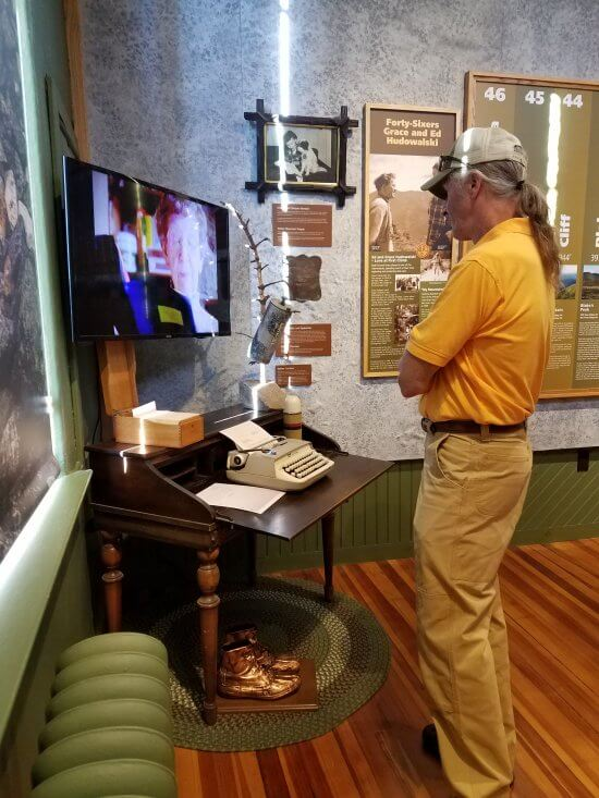 "The Adirondack History Museum opened its new exhibit, ""Hiking the Adirondack High Peaks"" with a reception and ribbon cutting. The event reflects on the history and role hiking has played in the development of the Adirondacks. (Photo provided by Adirondack History Museum)"