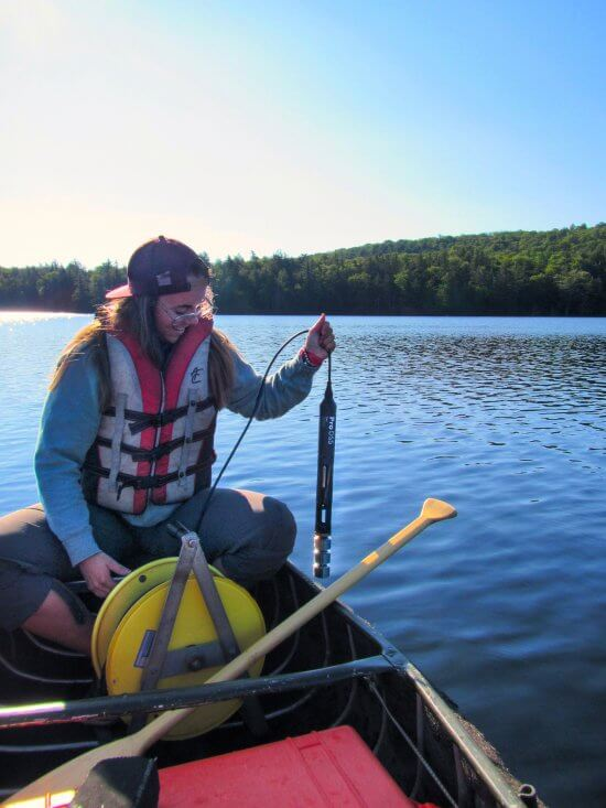 Collecting water quality data from Fawn Lake (Photo by Hamilton  County Soil and Water Conservation District)