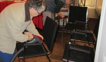 Volunteers at Hancock House Museum work to sanitize chairs in weeks before social distancing directive.