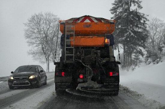 Plow salting the road