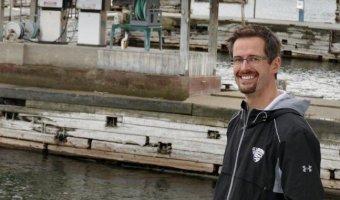 Essex Supervisor Ken Hughes in front of Essex Shipyard on Lake Champlain.